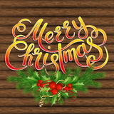 Christmas tree, holly and decorative elements on background of boards Royalty Free Stock Photo