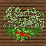 Christmas tree, holly and decorative elements on background of boards Royalty Free Stock Images