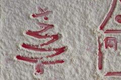 Christmas tree and home on flour background. White flour looks l Royalty Free Stock Photos