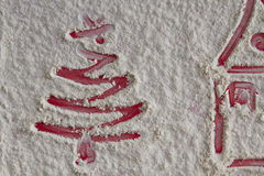 Christmas tree and home on flour background. White flour looks l Stock Photography