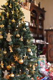 Christmas tree and house. A beautiful and decorated christmas tree with some presents under it stock photography