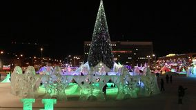 Christmas tree in Ice Town at night. PERM, RUSSIA - JAN 15, 2015: Christmas tree in Ice Town at night. Cost of construction and maintenance of town - 583 000 stock video footage