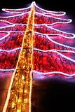 Christmas tree illumination with festive neon Lights at night. Christmas tree Illuminated with festive Neon Lights outdoor background card vertical royalty free stock photos