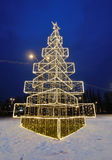 Christmas tree illuminated outdoor in the night Stock Images
