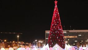 Christmas tree with illumination in Ice Town at night. PERM, RUSSIA - JAN 15, 2015: Christmas tree with illumination in Ice Town at night. Cost of construction stock video footage