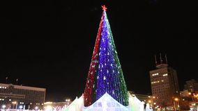 Christmas tree with illumination outdoor. At winter night stock video