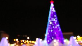 Christmas tree with illumination outdoor at winter night out of focus. Christmas tree with illumination outdoor at winter night stock video footage