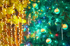 Christmas tree with illuminations. Close up of a Christmas tree with a background illuminations Royalty Free Stock Photos
