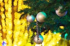 Christmas tree with illuminations. Close up of a Christmas tree with bokeh background illuminations Stock Photo