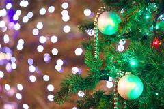 Christmas tree with illuminations. Close up of a Christmas tree with bokeh background illuminations Stock Images
