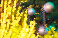 Christmas tree with illuminations. Close up of a Christmas tree with bokeh background illuminations Stock Image