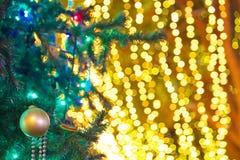 Christmas tree with illuminations. Close up of a Christmas tree with bokeh background illuminations Stock Photos