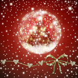 Christmas tree  inside shiny ball on red background Royalty Free Stock Images