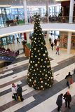 Christmas tree inside the shopping center. Decorated Christmas tree in the mall Stock Photography