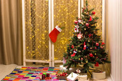 Christmas tree in the interior. Stock Image