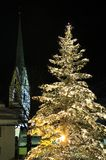 Christmas Tree in Ischgl. Night scenery at lighted Christmas tree and St. Nicolaus church in Ischgl - Austria Stock Photography