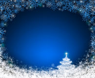 Christmas tree isolated on blue background. Merry Christmas and Happy New Year Card with Christmas tree and snow Stock Image