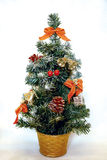 Christmas tree isolated. Small decorated christmas fir tree isolated on white background Royalty Free Stock Photo