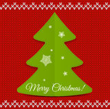 Christmas tree on knitted background with. Snowflakes. Merry Christmas Stock Photo