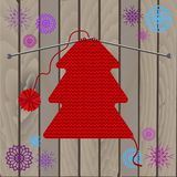 Christmas tree of knitted texture and snowflakes on wooden background. stock illustration