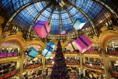 Christmas Tree at the Lafayette Gallery 2. A huge Christmas Tree and suspended gifts at the Lafayette Gallery in Paris, France Royalty Free Stock Photo