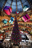 Christmas Tree at the Lafayette Gallery. A huge Christmas Tree and suspended gifts at the Lafayette Gallery in Paris, France Royalty Free Stock Photography