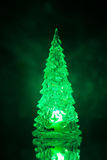 Christmas tree lamp green light with reflection Stock Image