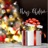 Christmas tree light background. Vector on dark with handwritten Merry Christmas and open gift box with fireworks Stock Image