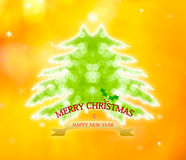 Christmas tree from light bokeh background. Greeting card.Abstra Stock Photos