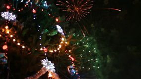 Christmas tree with light and firework. S. Outdoor stock video