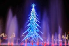 Christmas tree of light in london. With blue lights and Red water fountains stock photos