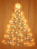 Christmas tree with light on wooden background Stock Photography