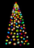 Christmas Tree Lighting. Lights in the shape of Christmas tree on black background Stock Images