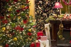Christmas tree lighting fireplace gift box stock photos