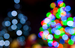 Christmas tree lights. Two blurred christmas tree lights on a black background Stock Photos