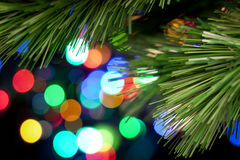 Christmas Tree Lights Background. A Christmas tree branch with glowing lights in the background Royalty Free Stock Photography
