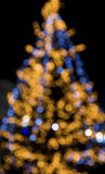 Christmas tree lights background. Defocused shot of a christmas tree decorated with lights, black background Royalty Free Stock Photos