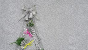 Christmas. Tree lights with bells ribbon bow and fans as decorations and copy space for your text