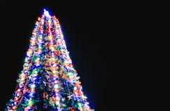 Christmas tree with lights on blue background Royalty Free Stock Photography