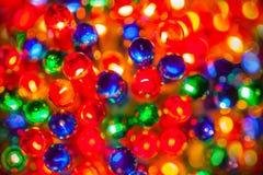Christmas tree lights bulbs closeup on bokeh colorful Royalty Free Stock Photography