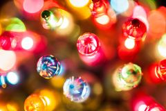 Christmas tree lights bulbs closeup on bokeh colorful. Background royalty free stock images