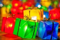 Christmas tree lights bulbs gift box closeup on wooden Stock Images