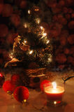 Christmas tree with lights and candles over black Royalty Free Stock Images