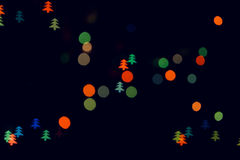 Christmas tree lights. Color blur on black backgrounds Royalty Free Stock Image