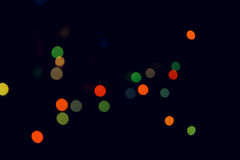 Christmas tree lights. Color blur on black backgrounds Royalty Free Stock Photos