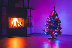Christmas tree with lights and fireplace Royalty Free Stock Photos