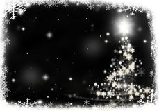 Christmas tree lights formed from stars background snow. Christmas tree lights formed from stars background blue Stock Photo