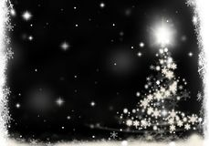 Christmas tree lights formed from stars background snow. Christmas tree lights formed from stars background blue Royalty Free Stock Photography
