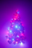 Christmas tree lights garland in frozen mist Stock Image