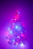 Christmas tree lights garland in frozen mist Stock Image